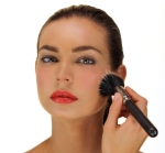 2nd Step apply brighter or darker shade of blush on apples of cheeks, blending and buffing into first layer of color.